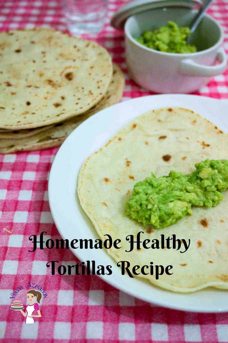 A Pinterest Optimized image for Homemade Healthy Tortillas recipe made with flour featuring a few homemade tortillas cooked perfectly.