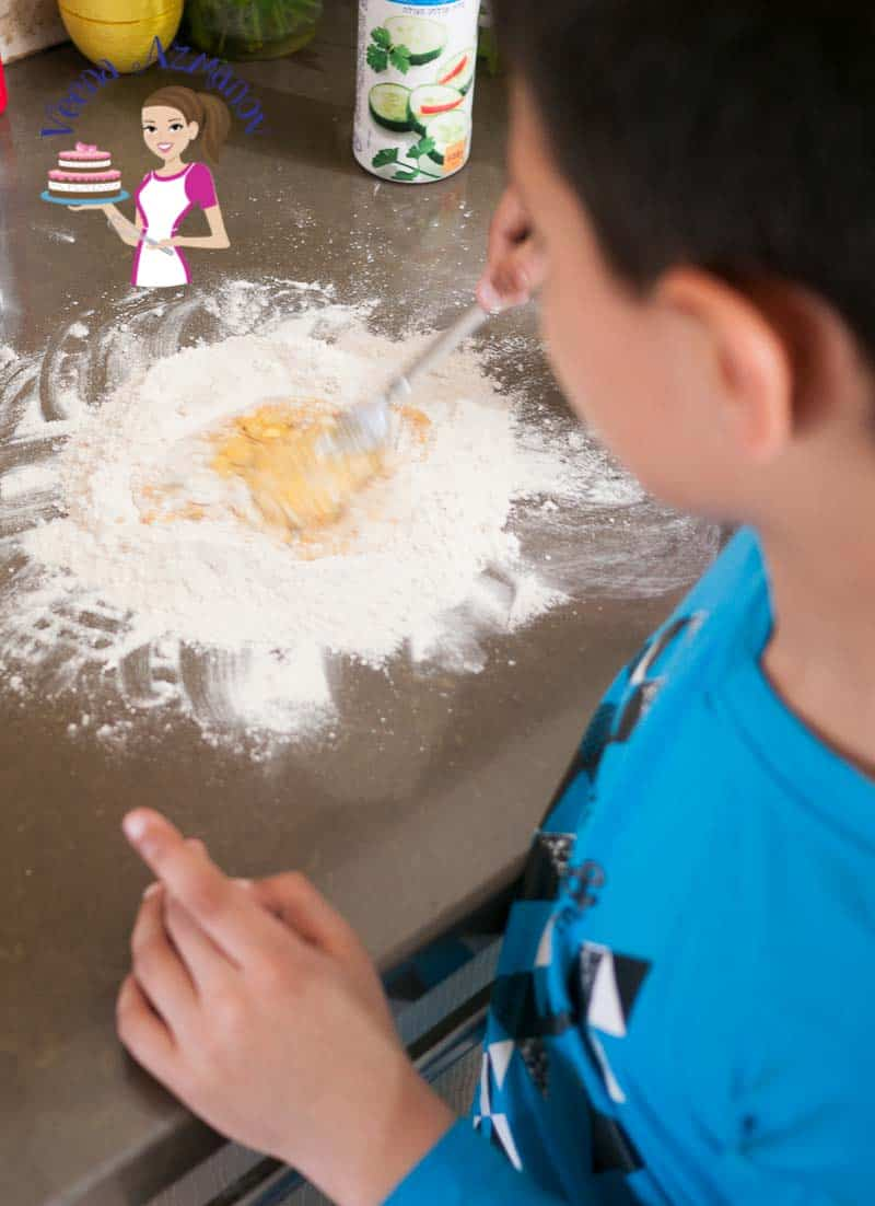 A child making homemade pasta.