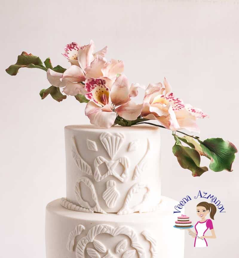 This Sugar Orchids and Lace Inspired Wedding Cake is inspired by the bride's lace and sugar orchids with a bronze hexagon tier at the bottom. A few details of the cake and how I achieved can be found below in this post.