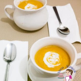 A cup of pumpkin and sweet potato soup.
