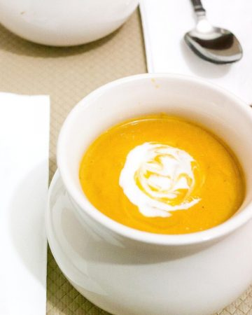 A bowl of pumpkin and sweet potato soup.