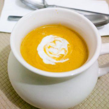 A bowl with pumpkin sweet potato soup.