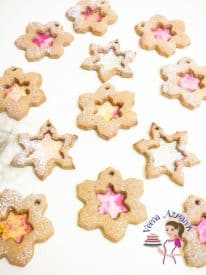These Snowflake Christmas Cookies are fun with hard candy centers. A fun Christmas project that is perfect for grown ups of kids. The cookie is richly spices with ginger, cinnamon and molasses giving it a gingerbread cookie flavor which is perfect for the season.