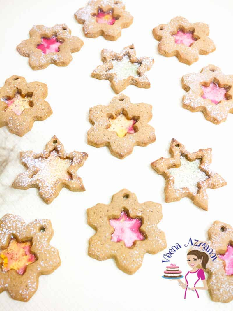 These Snowflake Christmas Cookies are made using kids favorite gingerbread cookie dough and hard candy. Such a fun project to get kids involved in Christmas baking. Just roll the dough; let them cut out the shapes and add the crushed candy.
