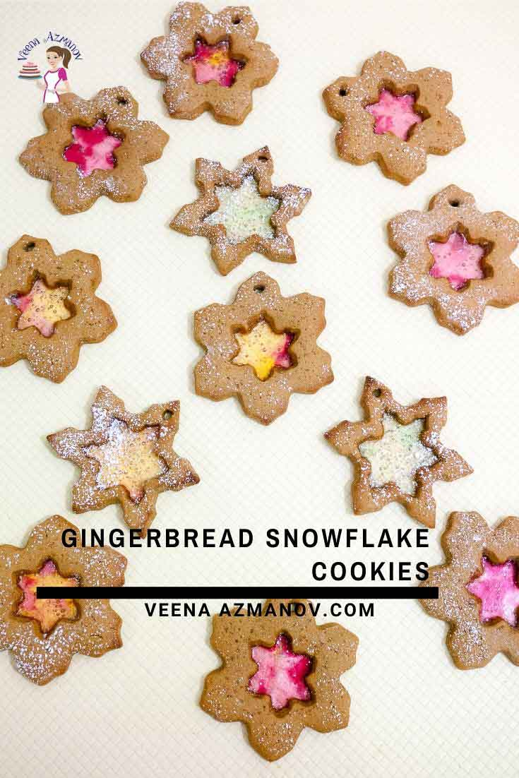 These Snowflake Cookies are a fun Christmas project for kids and grown-ups. Made with my no-spread gingerbread sugar cookie dough these use candy to create a stained-glass window effect. Spiced with ginger, cinnamon, nutmeg, and molasses this is a surprisingly simple and easy recipe to make #snowflake #cookies #baking #christmas #recipe #snowflakecookies via @Veenaazmanov
