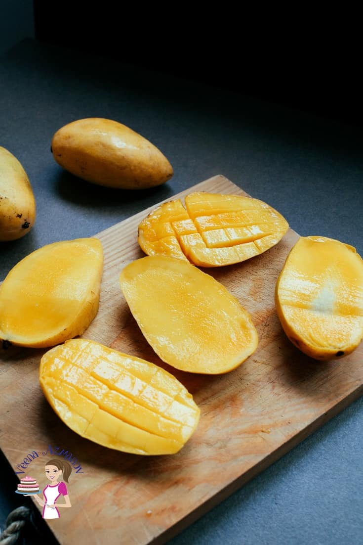 A Pinterest optimized image for 15 healthy eating habits for your family, featuring a sliced mango for cut fruits