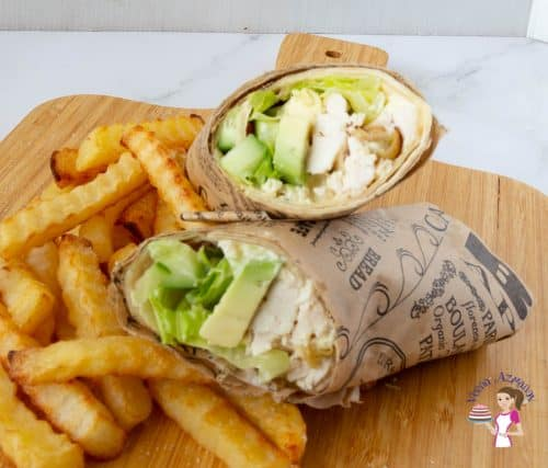 A chicken wrap on a wooden board