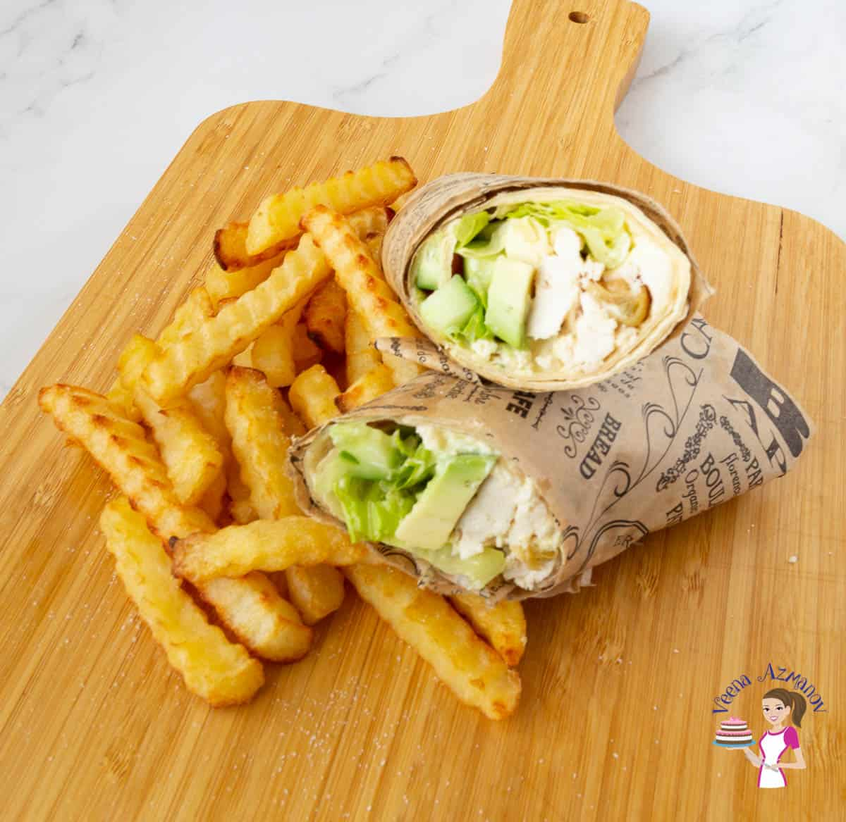 A tortilla sandwich wrap on a wooden board