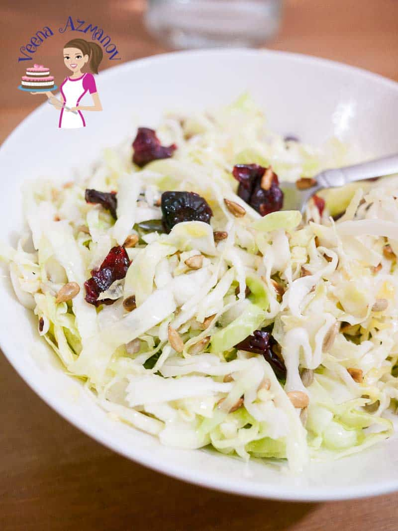 A light and refreshing yet simplest and easy salad to make is this cabbage salad dressed with toasted sunflowers seeds and sweet cranberries. I keep the nice crunch of freshness but not the raw bite of leaves and I'll show you how.