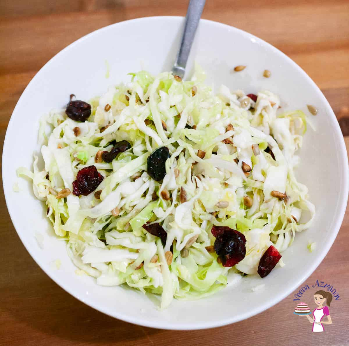 A white bowl with white cabbage salad