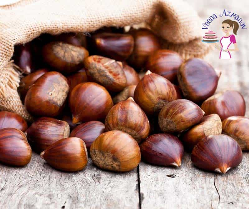 A stack of chestnuts on a table.