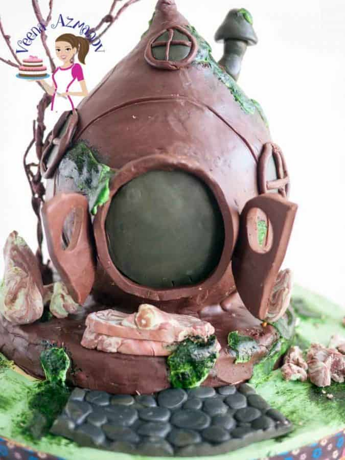 A Bird House Cake is a great gift for kids who love something a little different and more than just castles and towers. This was inspired by the little Hobbit homes with an earthy rustic feel.