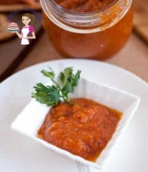 A tepenade is a must have on hand for easy sandwich spreads, tortilla wraps and appetizers. This roasted red pepper garlic tepenade is our family favorite, super easy, quick and simple to make. You will be totally addicted to it. Ingredients 4 large Red Pepper 2 whole Garlic Bulbs 1/4 cup Olive Oil Salt and Pepper to taste Method Roast Red Peppers Wash and clean red peppers Cut in half and de-seed Line a baking tray with aluminium foil Place peppers skin side down on the foiled tray Bake at 200 C / 400 F for about 30 minutes turning them skin side up about half way thru When roasted the skin will be black. Take it out from the oven Leave them on the baking try lined with aluminum foil Gather the corners of the aluminium foil up over wrapping the red peppers completely Let cool wrapped for about 10 minutes - this will help the skin just peel off the peppers. After 10 minutes skin the red peppers - cooling them wrapped helps separate the skin from the flesh. Roast Garlic Leave the garlic bulbs skin on. Cut off the tail end slightly so you expose the garlic (see picture below) Place them on a piece of aluminum foil large enough to wrap the bulbs Add a tbsp olive oil, sprinkle salt and pepper wrap the garlic bulbs into foil Place in the oven with the red peppers at 200 C / 400 F for about 30 mins. After 30 minutes take them off the oven and let cool in the foil Once cooled it's easy to just pick the garlic off the bull into a small bowl. Two bulbs should make about 1/3 cup Make the Tepenade Place the red peppers and roasted garlic in a food processor Pulse for a few seconds Add salt and pepper to taste. Then pour in the olive oil slowly while still processing. Taste for seasoning before you transfer to a jar Place in the fridge until ready to use. This will stay fresh in the fridge for up to two weeks.
