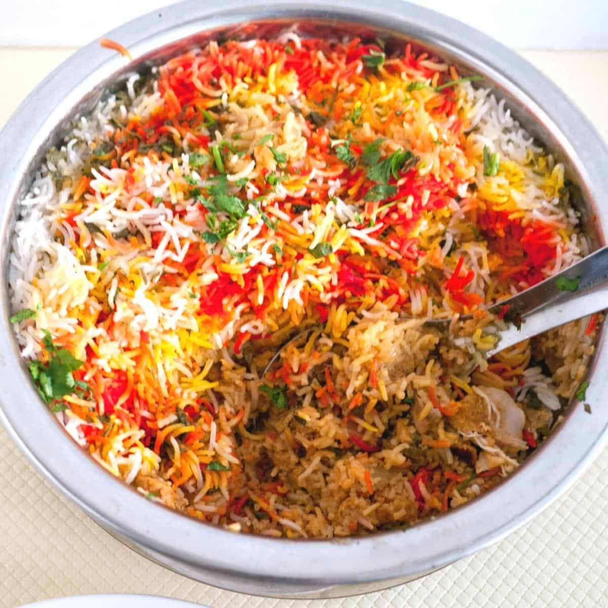 Hyderabad Dum Biryani Pot with chicken.