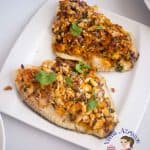Baked fish fillets on a plate.