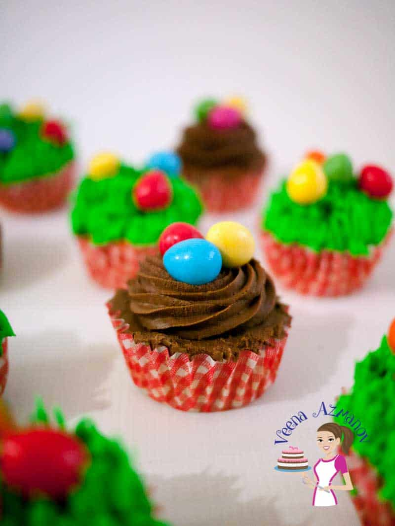 A Close of this Festive Carrot Cupcakes this one is piped with a brown swirl and topped with easter eggs as a nest