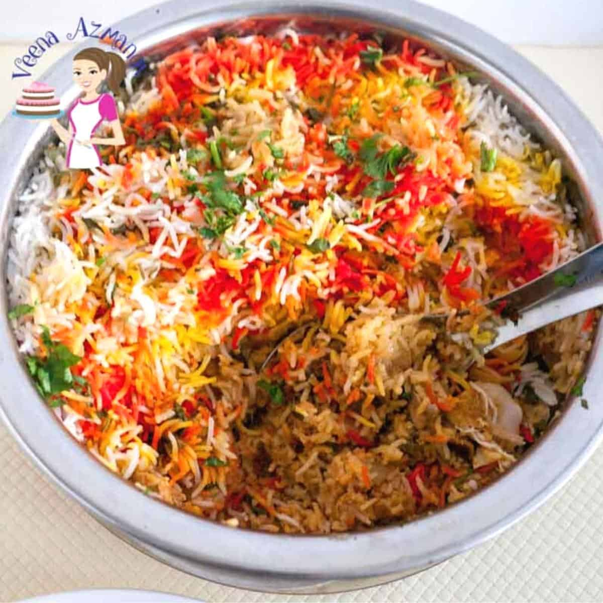 A metal pot with chicken biryani