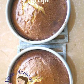 Two sponge cakes in a baking pans.