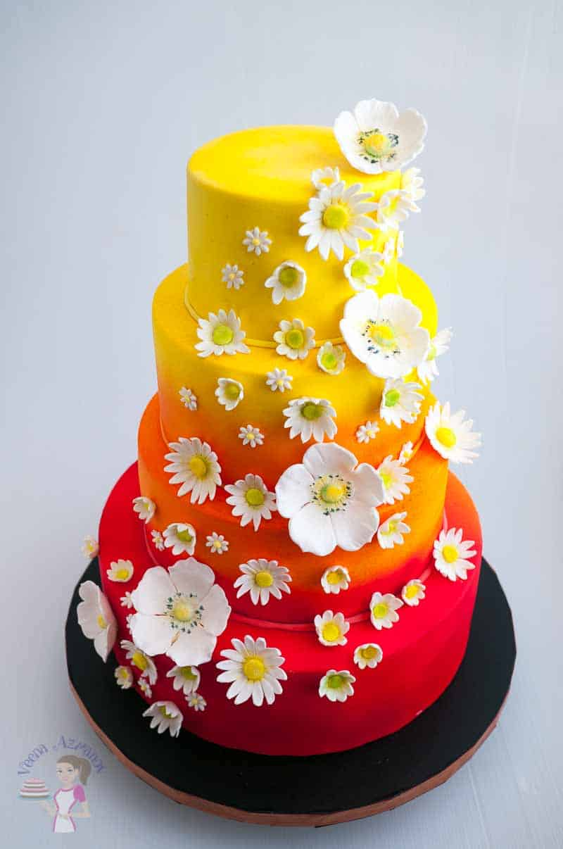 A cake decorated with gum paste flowers.