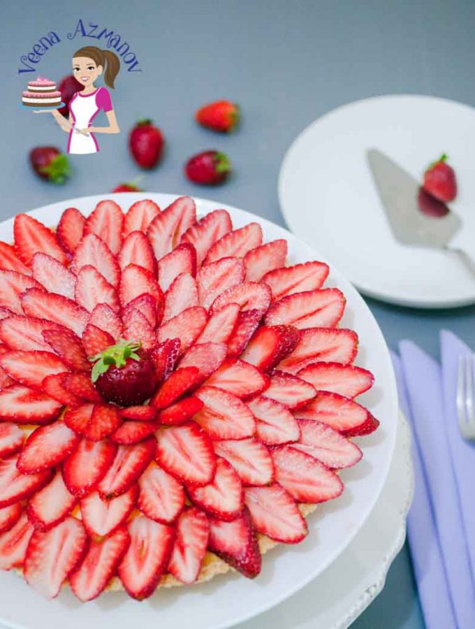 Make a picture perfect Fresh Strawberry dessert made with buttery shortcrust pastry, rich creamy pastry cream and fresh strawberry slices.
