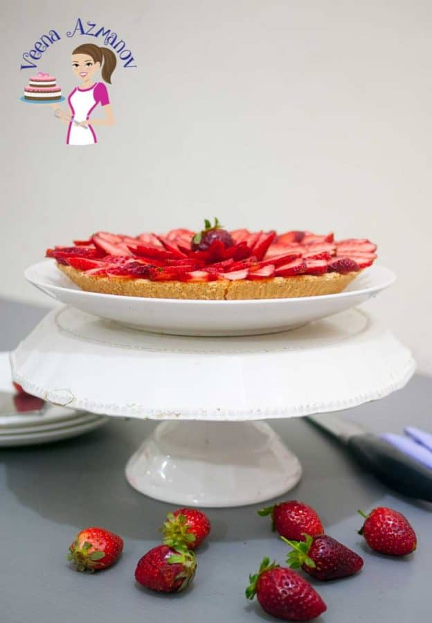 A delicious strawberry Tart is made with buttery short crust pastry baked to perfection, filled with rich luxurious vanilla pastry, dressed with slices of seasonal strawberries and glaze with shiny strawberry jam.