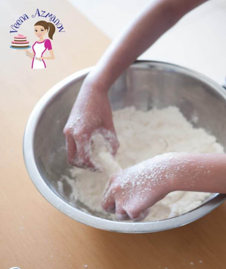 A person making dough.