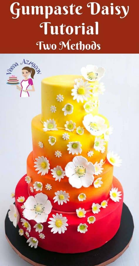 A cake decorated with gum paste daisies.