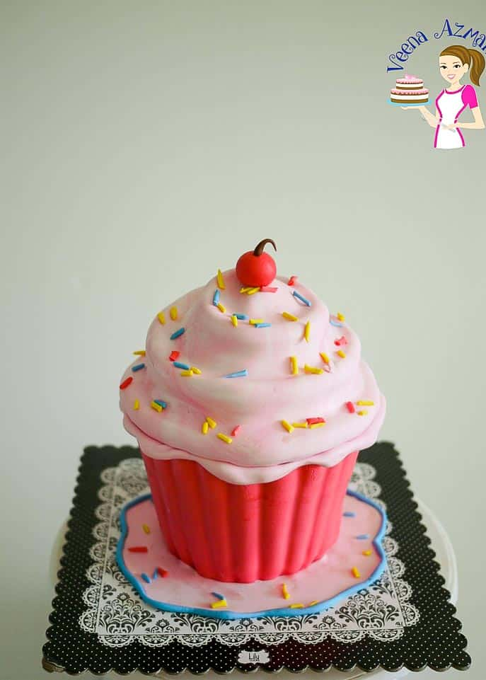 A top view for how to make this giant cupcake cake tutorial - progress pictures from start to finish... with a cherry on top.