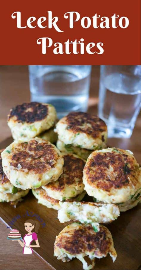 A stack of leek and potato patties on a wooden tray.