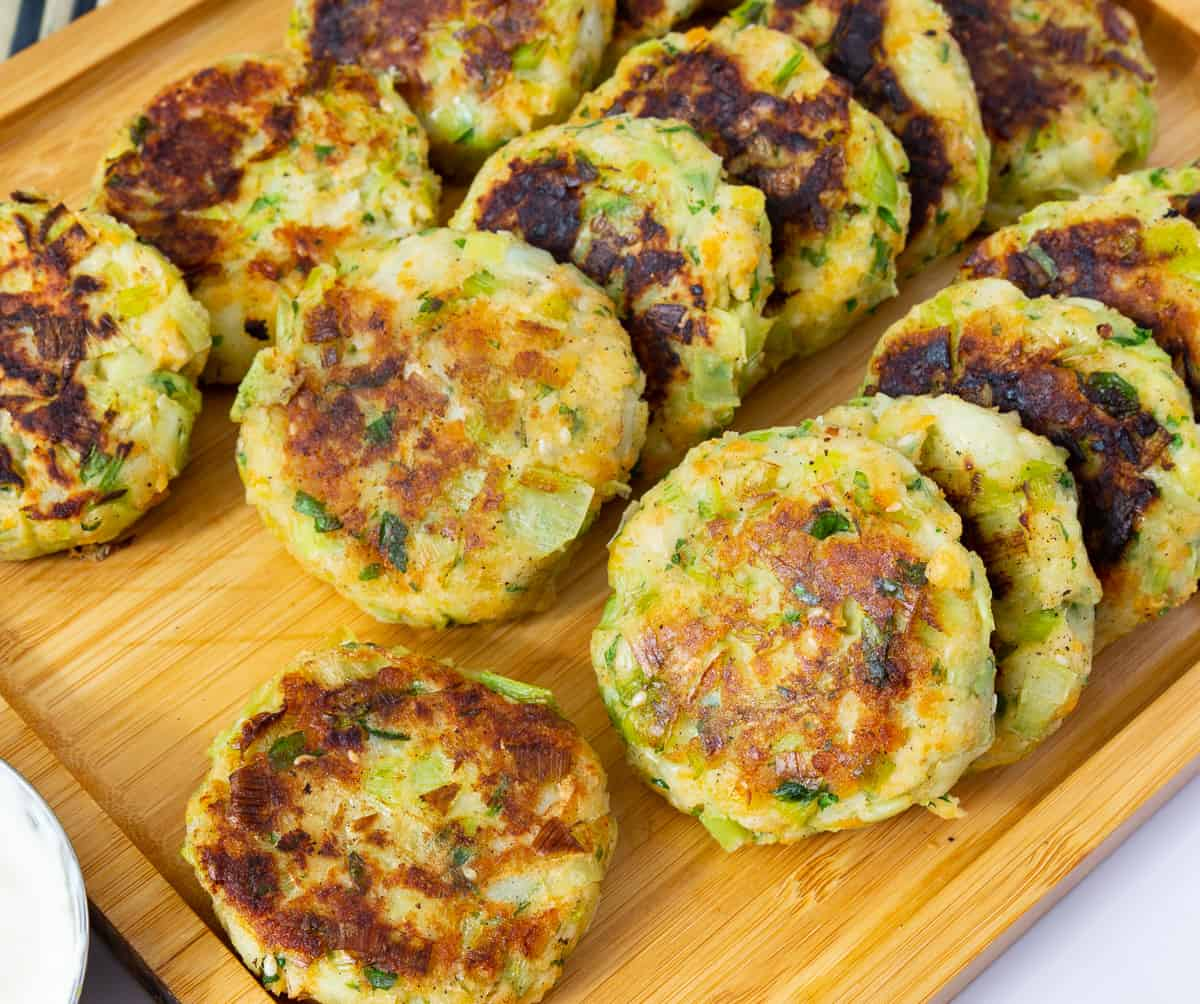 Patties on a platter with cream cheese dip.