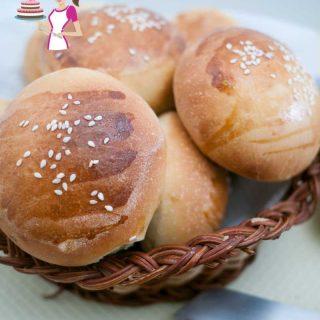 A basket with soft hamburger buns.