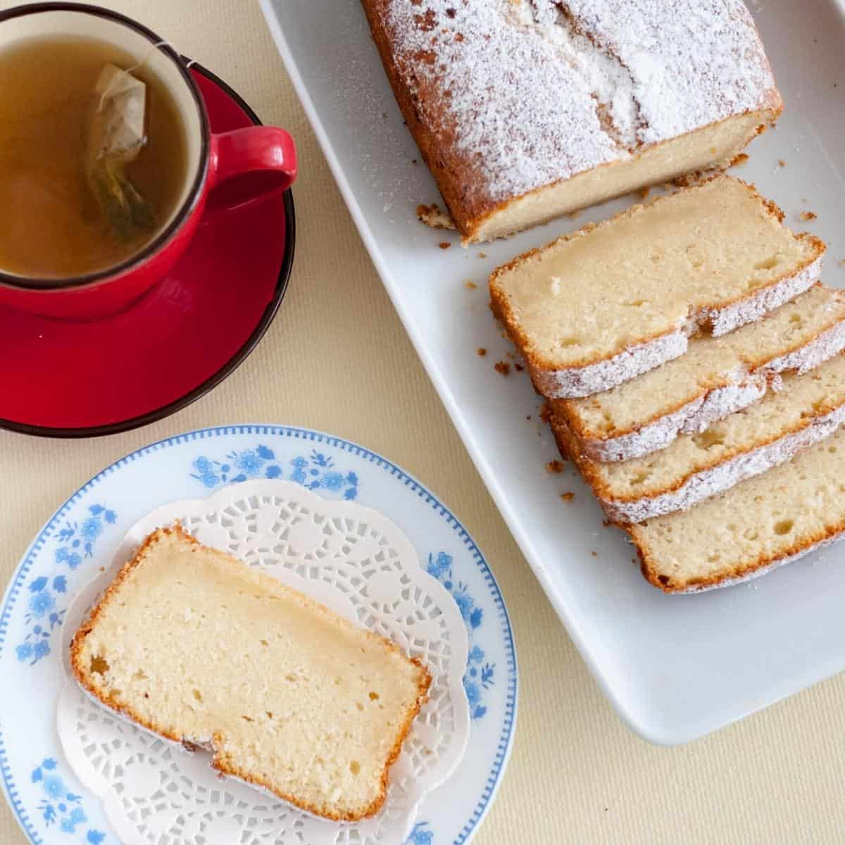 A loaf of pound cake with slice of vanilla pound.
