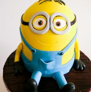 A minion cake makes a perfect celebration cake for kids any age be it a boy or girl. This simple, easy and effortless minion cake tutorial with step by step progress pictures makes cake decorating fun. Whether you make Dave the minion or Kevin the minion there's is bound to be a kid in your life that would adore this cake.