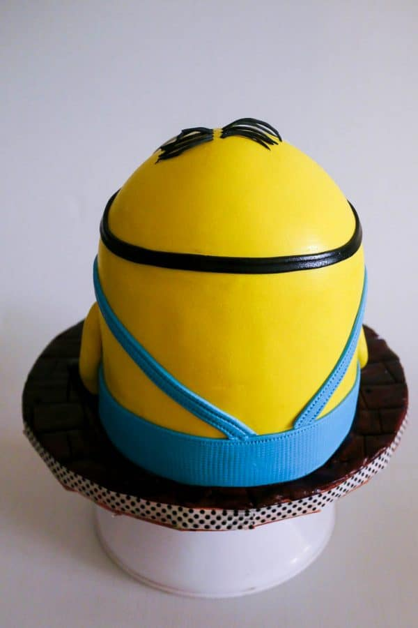 A cake decorated to look like a minion.