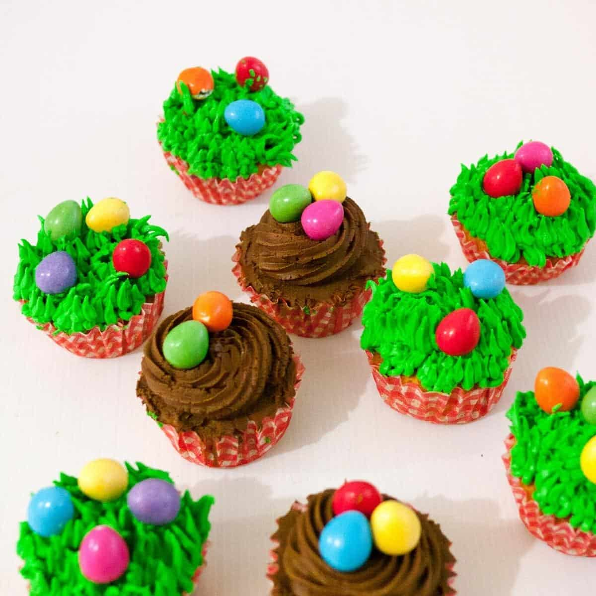 Frosted cupcakes topped with candy eggs