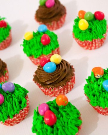Frosted carrot cupcakes for easter with candy eggs.