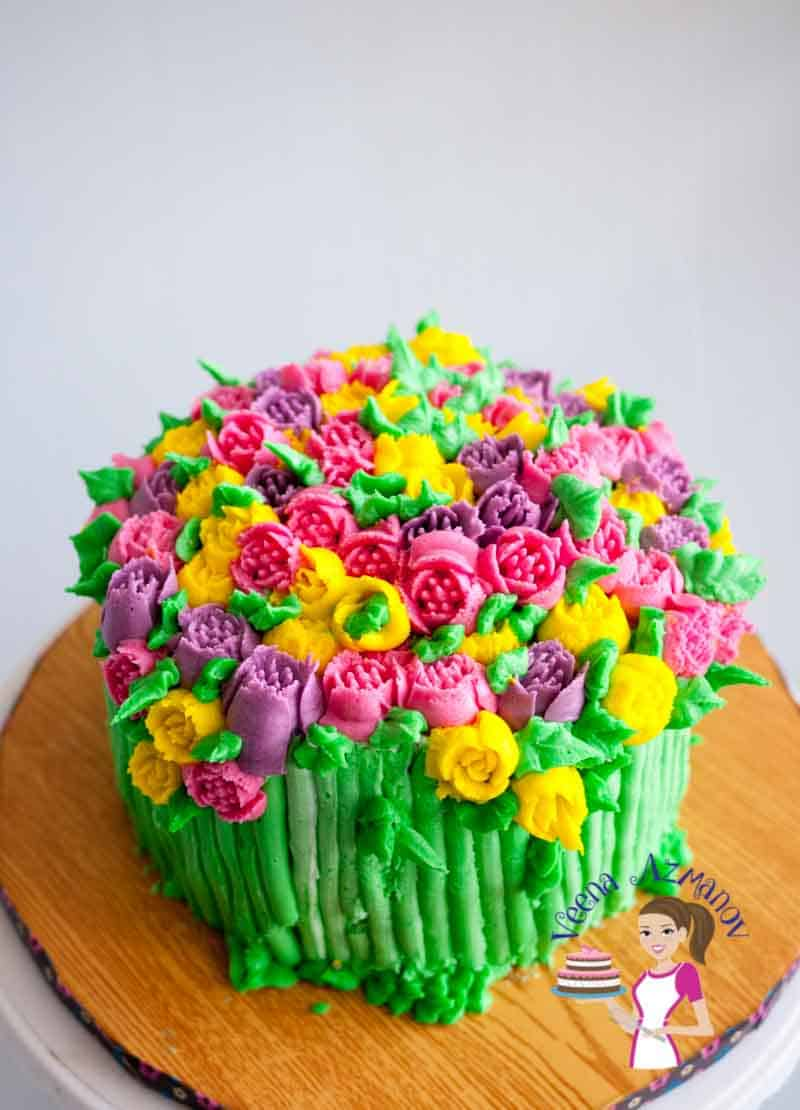 A cake decorated with buttercream flowers.