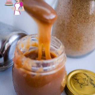 A pouring shot of the butterscotch sauce showing how thick this butterscotch recipe is