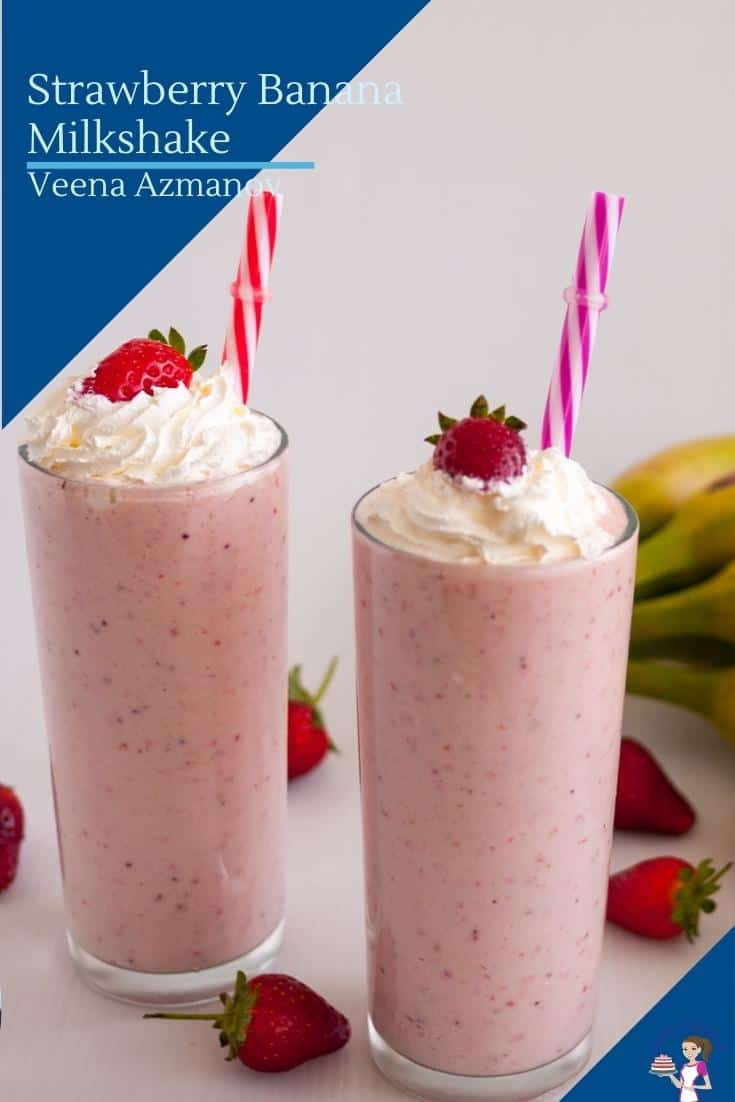 Two glasses with milkshake topped with strawberry