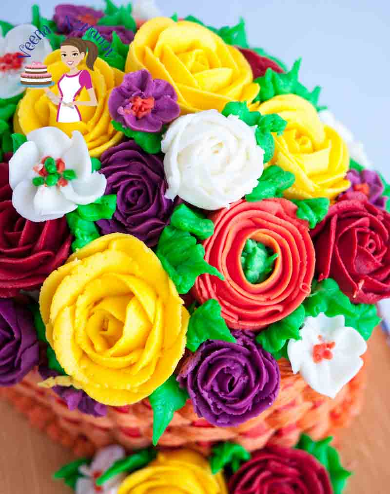 A close up of a cake decorated like a basket of flowers.