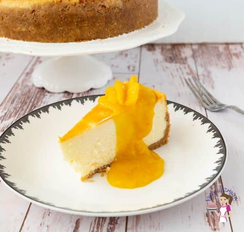 A slice of mango cheesecake on a plate.