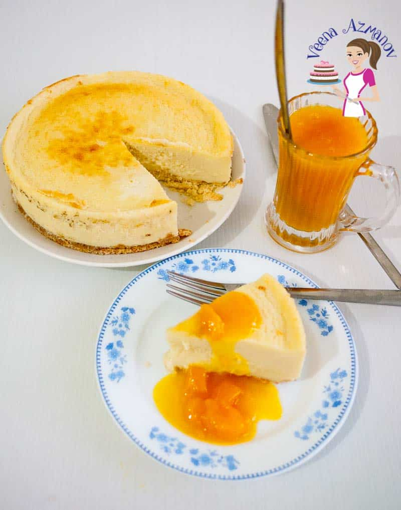 A slice of cheesecake on a plate with mango filling