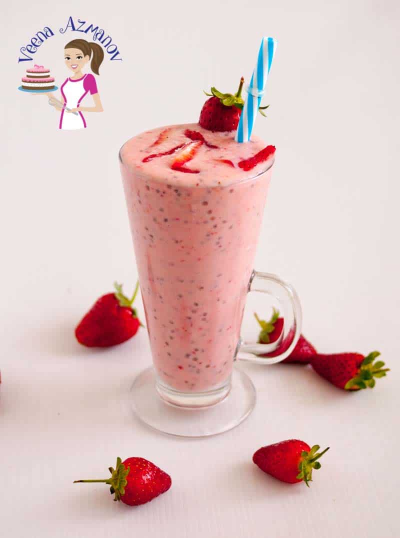 Image showing a glass full of berry chia smoothie with chopped strawberries on top
