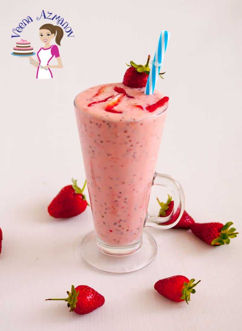 Extra image of the berry chia smoothie show casing the pretty color of the drink featuring fresh strawberries