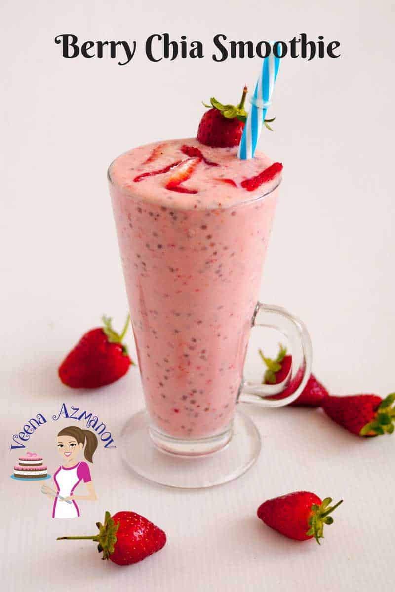 A Pinterest optimized images showing a glass of Berry Chia Smoothie garnished with fresh strawberries and a blue straw