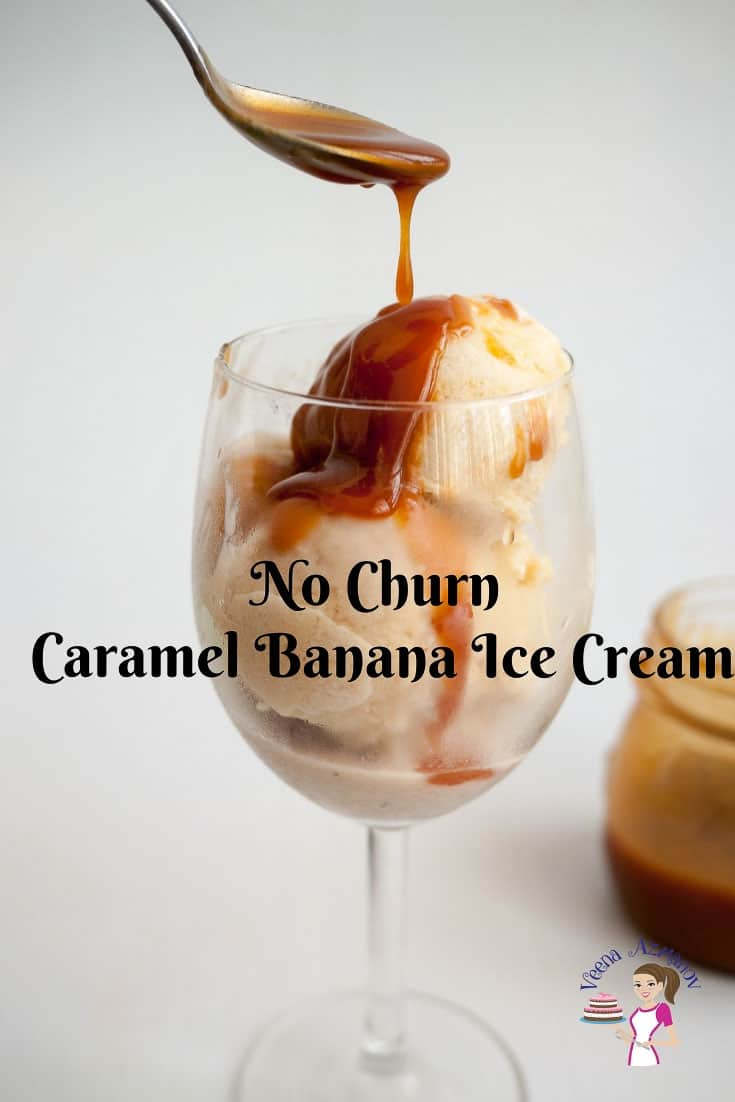 Two scoops of banana ice cream in a wine glass topped with caramel sauce