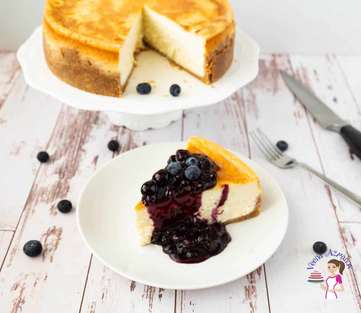 A slice of cheesecake with blueberry sauce.