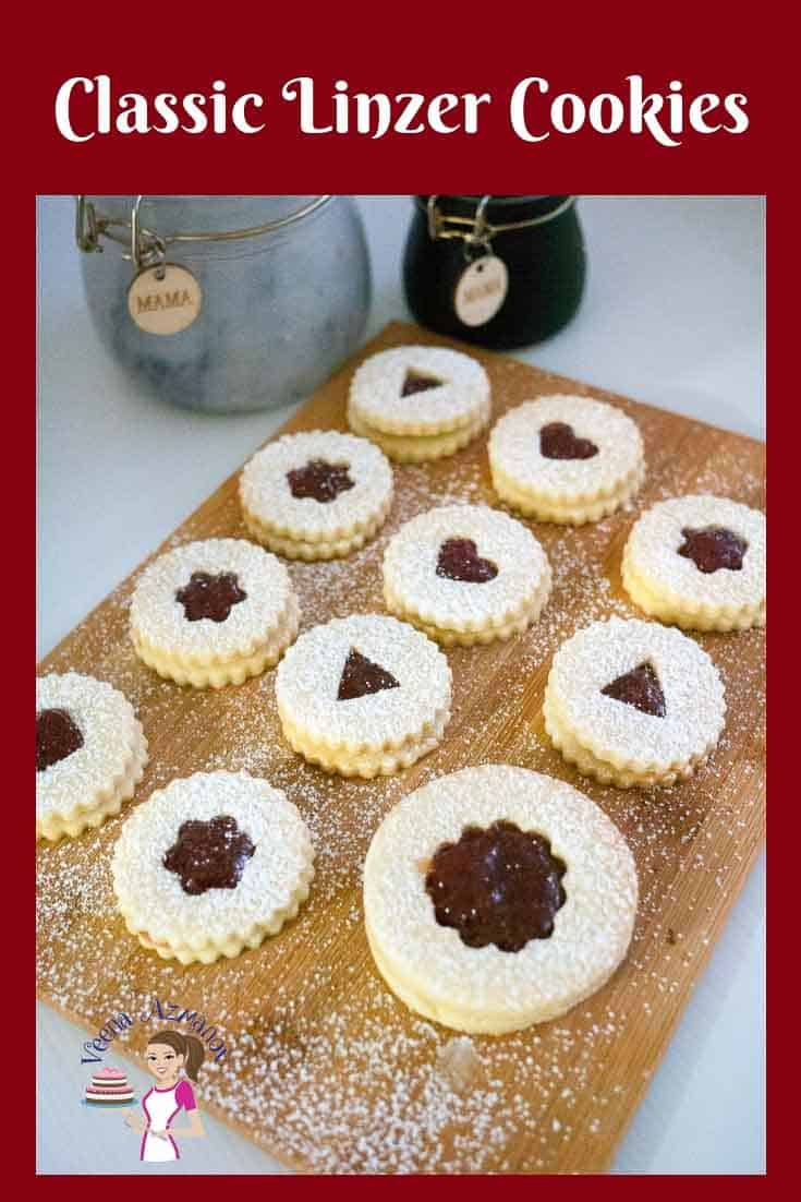 These classic Linzer cookies are battery crumbly shortbread jam sandwich cookies that make perfect holiday cookies to gift family and friends.