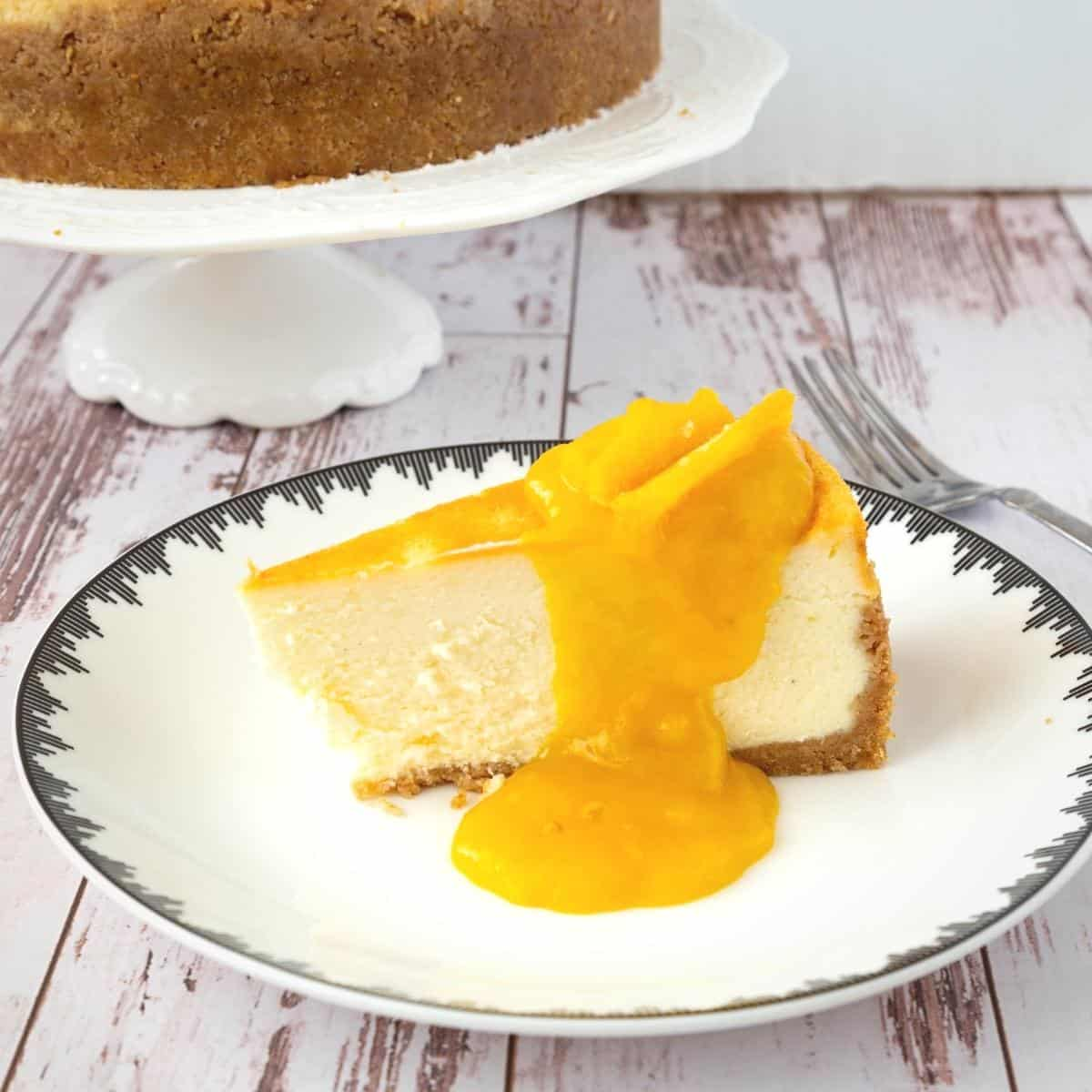 A slice of cheesecake with mango filling.