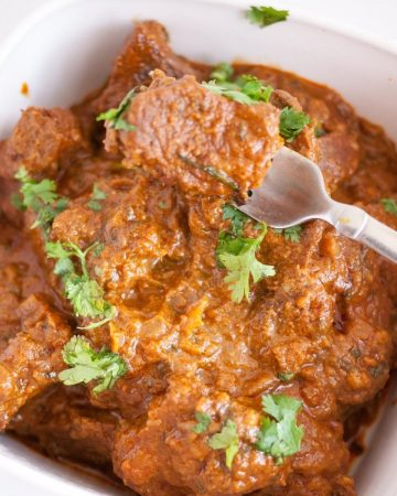slow cooked beef in a serving dish.
